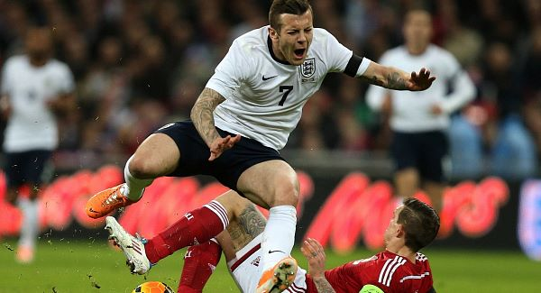Agger defends himself over Wilshere tackle